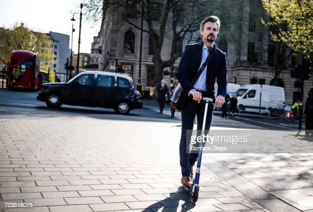 Businessman on scooter, London, UK