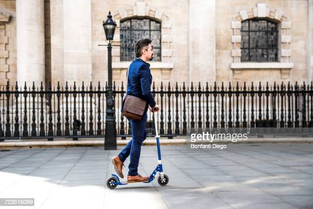 Businessman on scooter, London, UK