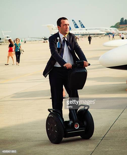 businessman on segway - segway stock pictures, royalty-free photos & images