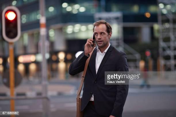 Businessman on street talking on the phone