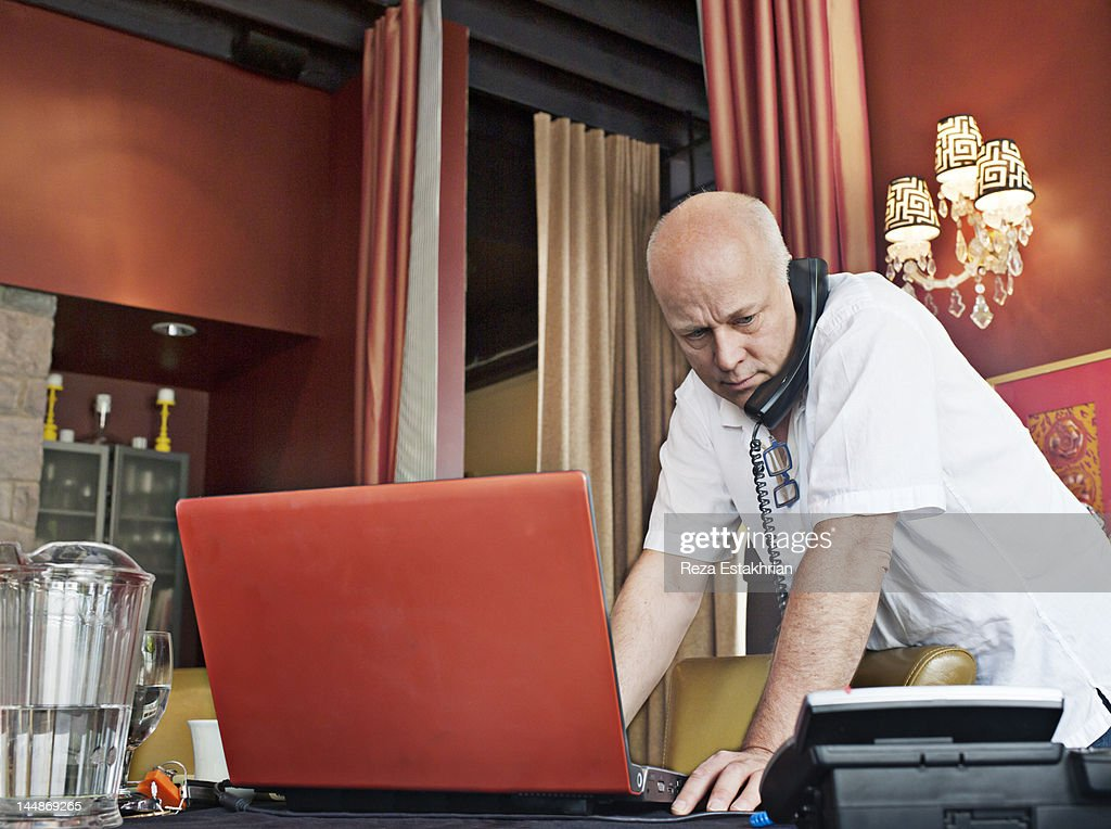 Businessman on telephone checks his email : Foto de stock