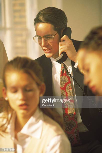 businessman on telephone in office with others - category:cs1_maint:_others stock pictures, royalty-free photos & images