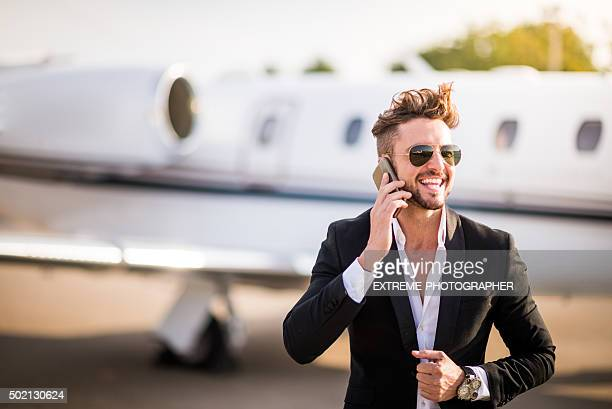 Businessman on the airport talking over mobile phone