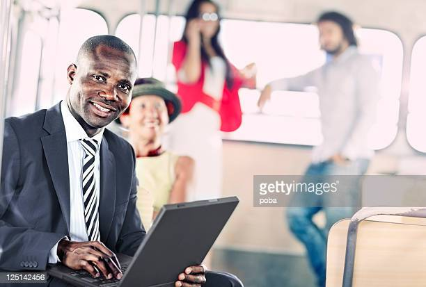 businessman On The Move  goes to work by city  bus
