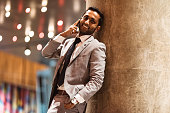 businessman on the phone at night in the city