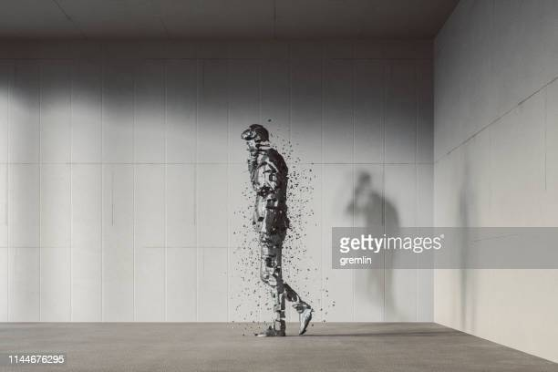 businessman on the phone disintegrating in the modern concrete office - incomplete stock pictures, royalty-free photos & images