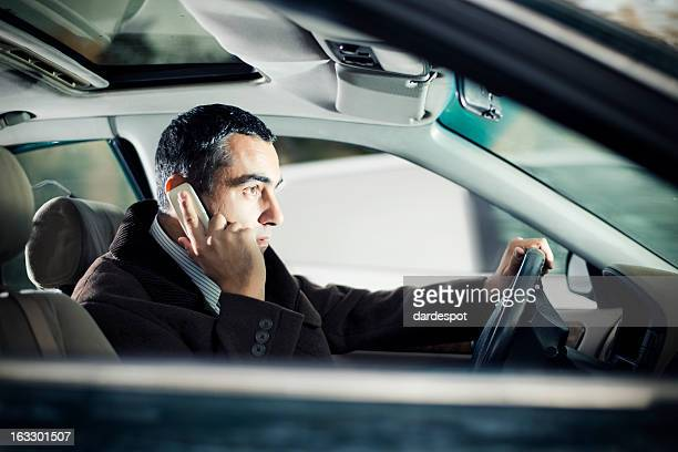 Businessman On The Phone in car