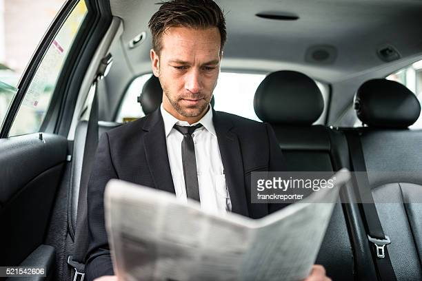 businessman on the phone in the taxi