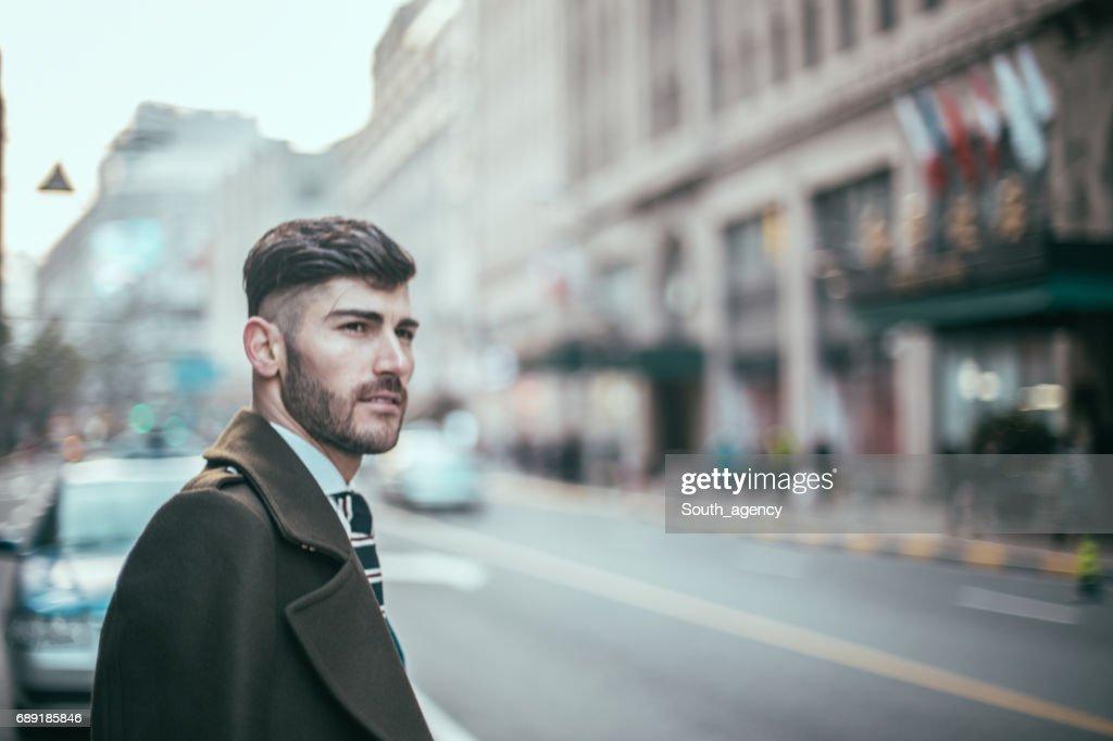 Businessman on the sidewalk : Stock Photo