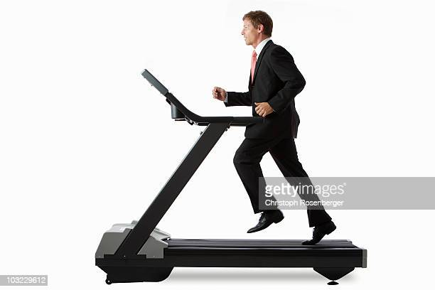 Businessman on treadmill running in place