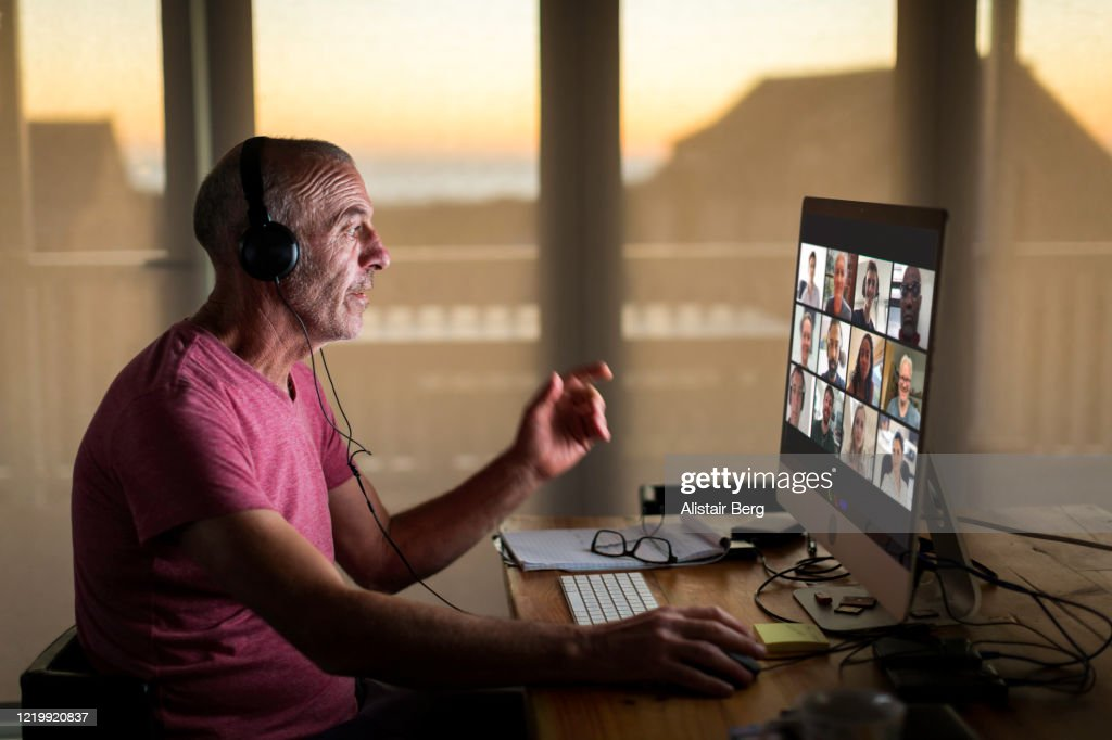 Businessman on video call from home during lockdown : Stock Photo