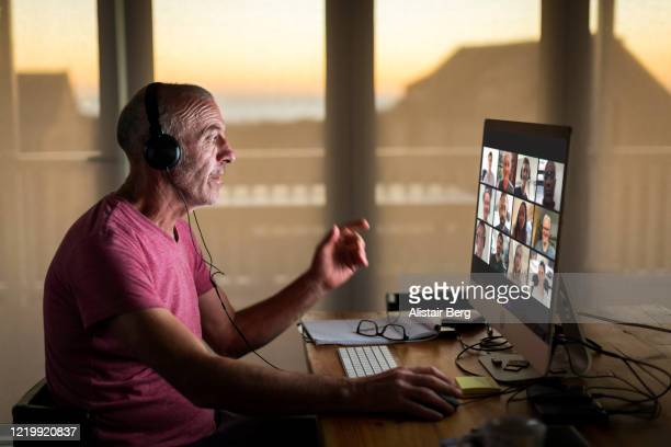 businessman on video call from home during lockdown - working from home stock pictures, royalty-free photos & images
