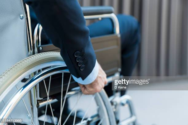 businessman on wheelchair - accessibility stock pictures, royalty-free photos & images