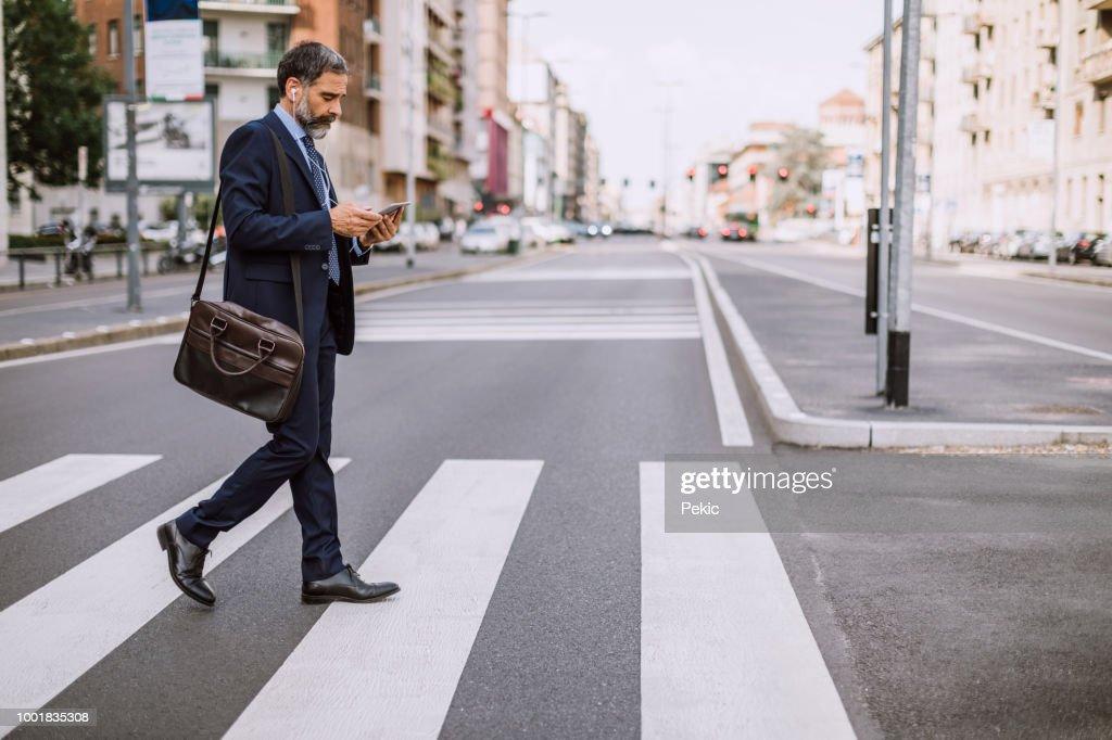 Businessman On Zebra Crossing : Stock Photo