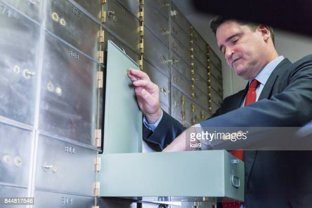 Businessman opening a safety deposit box