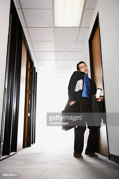 Businessman opening door
