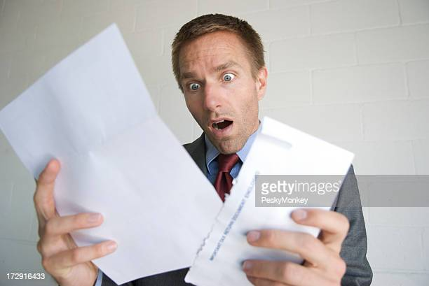 Businessman Opening Letter with Shocked Expression