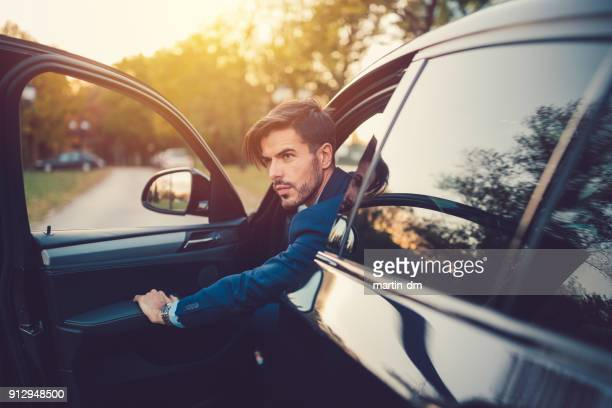 Businessman opening the car door