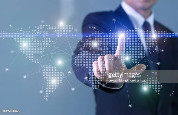 businessman operating virtual hud interface and manipulating elements with. - global communications stock pictures, royalty-free photos & images