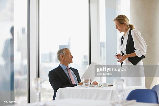 Businessman ordering lunch in elegant restaurant