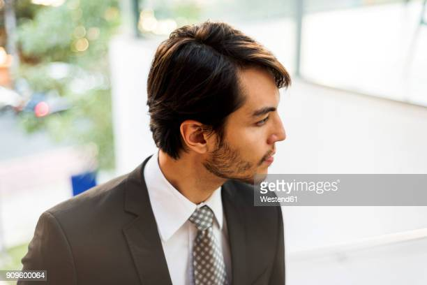 Businessman outdoors looking around