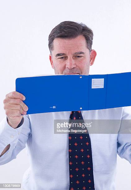 Businessman, over 50, with bank receipts