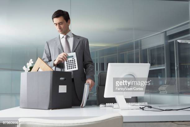 businessman packing office belongings - endopack stock pictures, royalty-free photos & images
