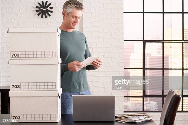 Businessman Packing Office