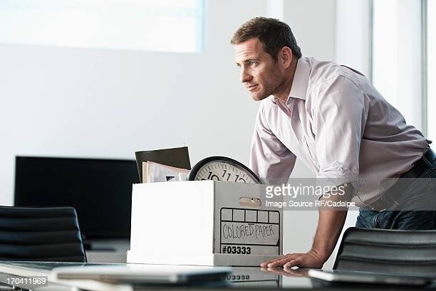 businessman packing up box in office - quitting a job stock pictures, royalty-free photos & images