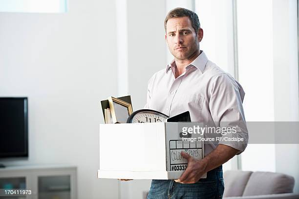 Businessman packing up box in office
