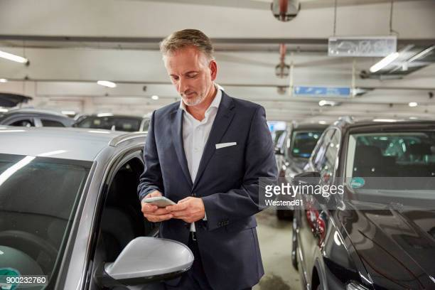 businessman parking his car at the airport - parking garage stock pictures, royalty-free photos & images