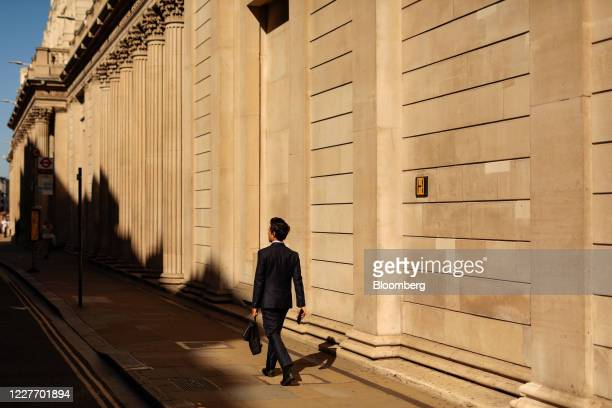 A businessman passes the Bank of England in the City of London UK on Monday July 20 2020 UK Prime Minister Boris Johnson nudged Britons back to their...