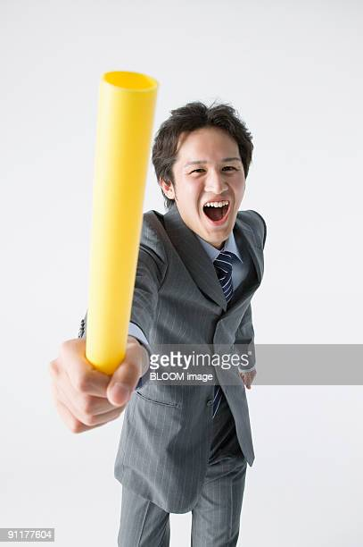 Businessman passing baton