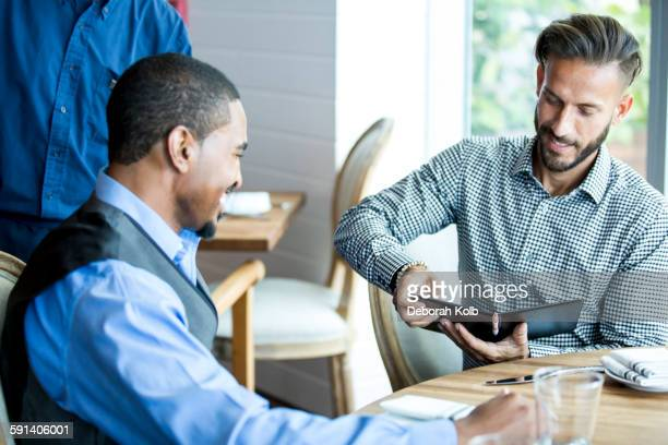 Businessman paying for lunch in cafe