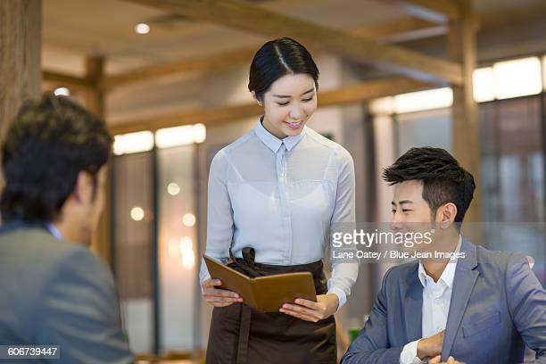 Businessman paying the bill in restaurant