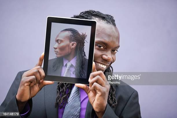 Businessman Peeking From Behind Digital Tablet