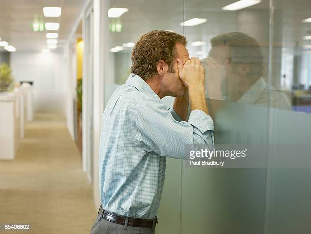 businessman peering into conference room - curiosity stock pictures, royalty-free photos & images