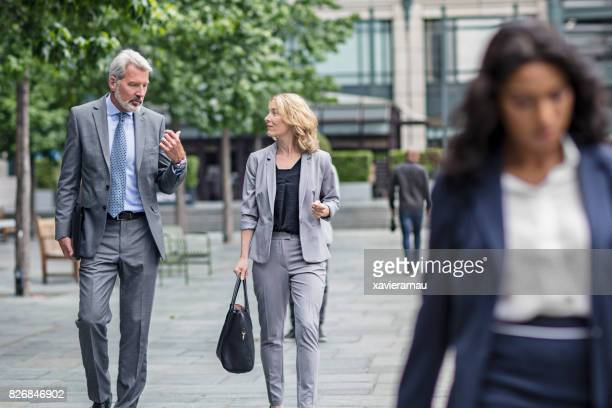 Businessman people talking and walking in city