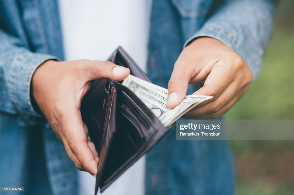 Businessman Person holding an wallet in the hands of an man take money out of pocket. : Stock Photo