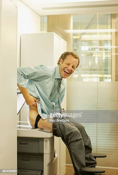 businessman photocopying his buttocks - wasting time stock pictures, royalty-free photos & images