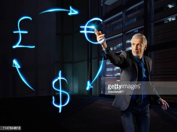businessman pianing currency curculation with light - blood flow stock pictures, royalty-free photos & images