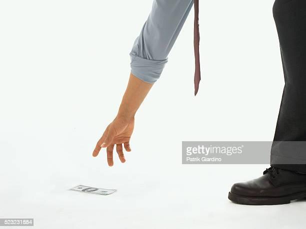 Businessman Picking Up $100 Bill