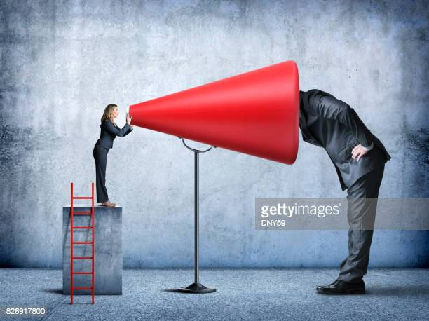businessman places his head inside a big red megaphone - listening stock pictures, royalty-free photos & images