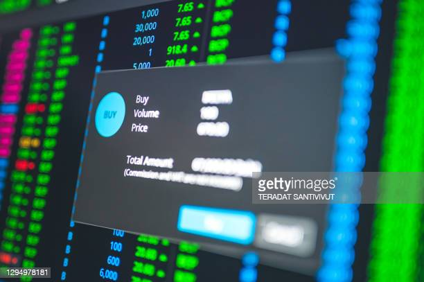businessman planning to buy stock invest in growth stock and cryptocurrency by online platform - cryptocurrency stock pictures, royalty-free photos & images