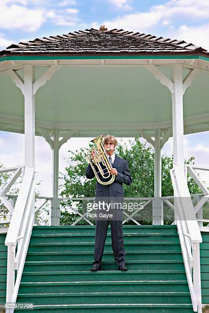 Businessman Playing a Tuba