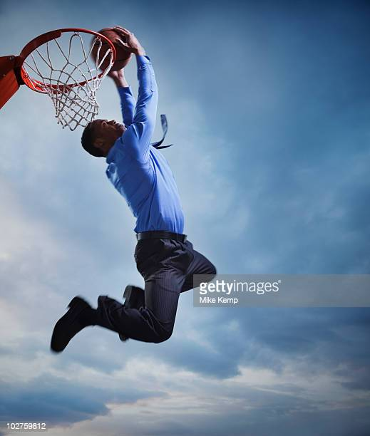 Businessman playing basketball
