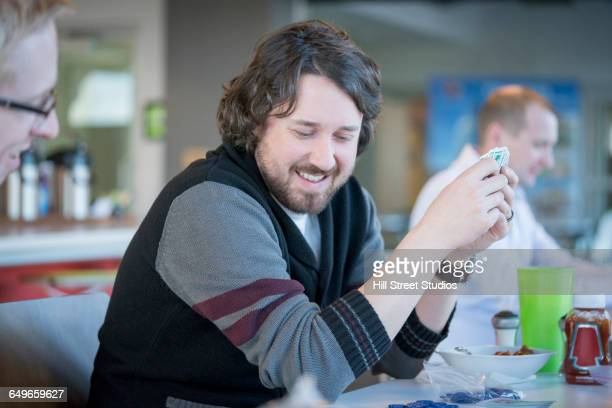 Businessman playing cards in office lounge