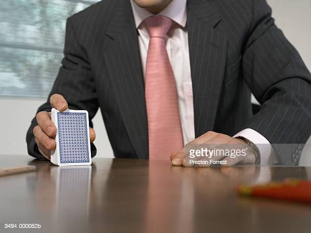 Businessman Playing Cards