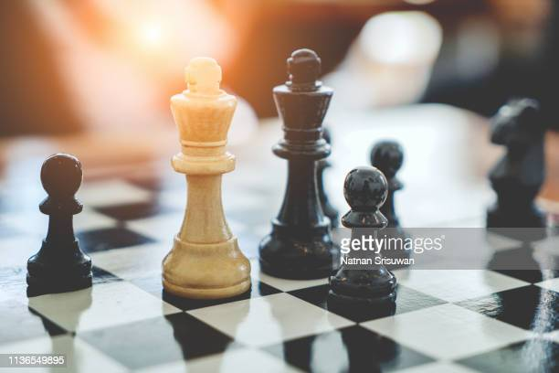businessman playing chess game. - defending stock pictures, royalty-free photos & images