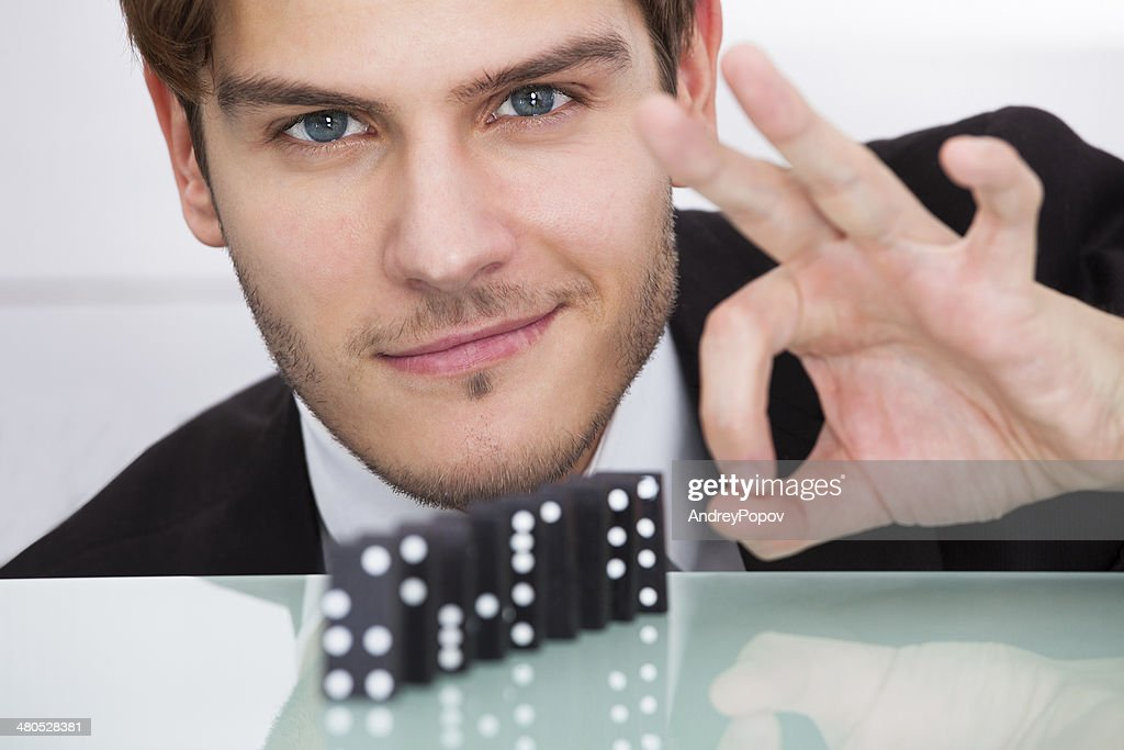 Businessman Playing Domino : Stock Photo